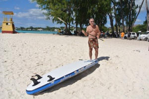 Dad prepares to do some paddle-boarding