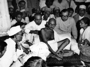 Gandhi sitting with Khalifat Movement activists