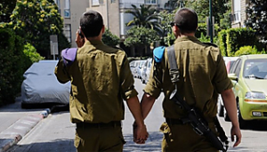 Two Israeli soldiers hold hands