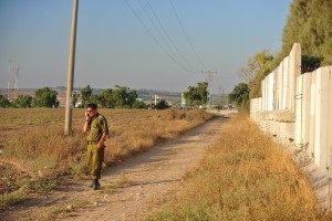 A soldier at a roadway lookout near Kibbutz Kafar Gaza