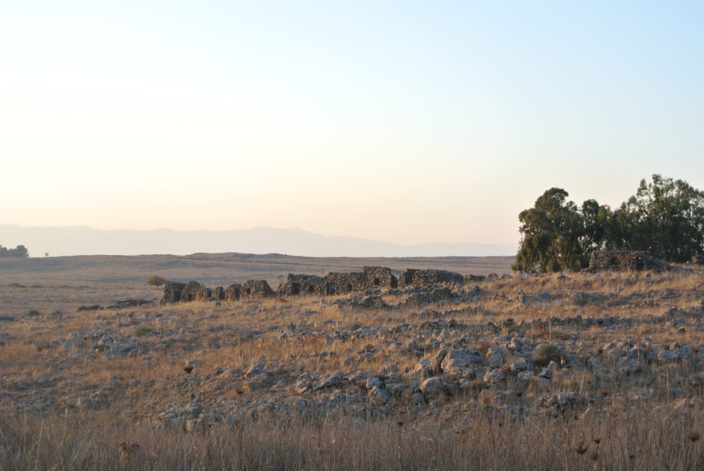 Sun sets over the Golan, the stone walls of an old village (Seth J. Frantzman)
