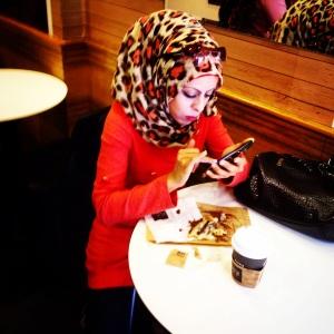 An Arab woman at a Jerusalem Aroma cafe