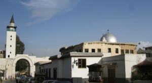 A church and mosque next to eachother in Syria