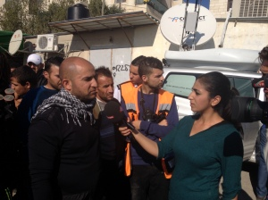 A Palestinian woman interviews a man last year (Seth J. Frantzman)