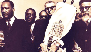 Abraham Joshua Heschel with Martin Luther King, he did more than just host a seder