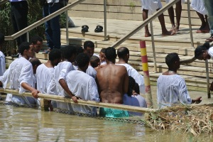 Eritrean men enter the Jordan River on the Israeli side (Seth J. Frantzman)