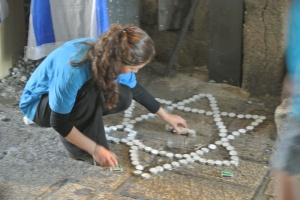 A Jewish woman at the site of the stabbing on October 3. (Seth J. Frantzman)