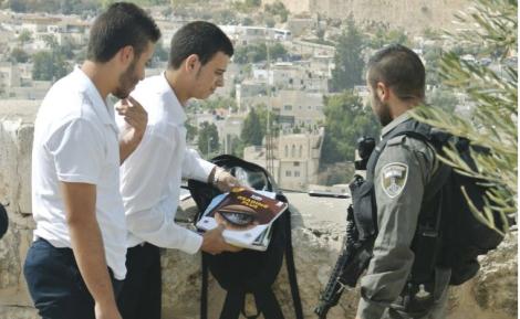 Border police search the bags of two Palestinians in Ras al Amud (Seth J. Frantzman)