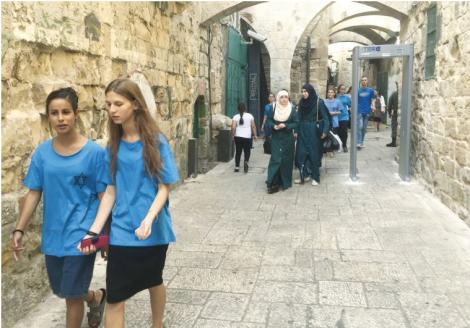 Jewish and Arab women walk in the Old City of Jerusalem by Seth J. Frantzman
