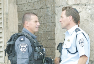 Micky Rosenfeld meets with a Yasam commander named Yaron Levy at Lion's Gate. (Seth J. Frantzman)