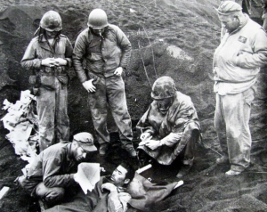 Americans on Iwo Jima with a Japanese survivor of the battle. Good PR here?