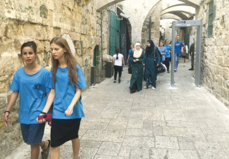 Jewish and Arab women walk in the Old CIty. (Seth J. Frantzman)