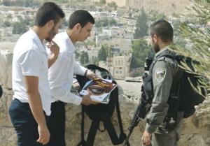 Palestinian youth being checked in Ras al-Amud (Seth J. Frantzman)